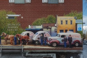 mural in front of islington seniors centre depicting the evolution of the Gordon's dairy company