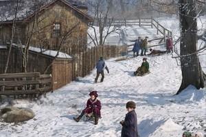 mural of children toboganning