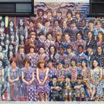 mural showing many people facing forward smiling of different ethnicities